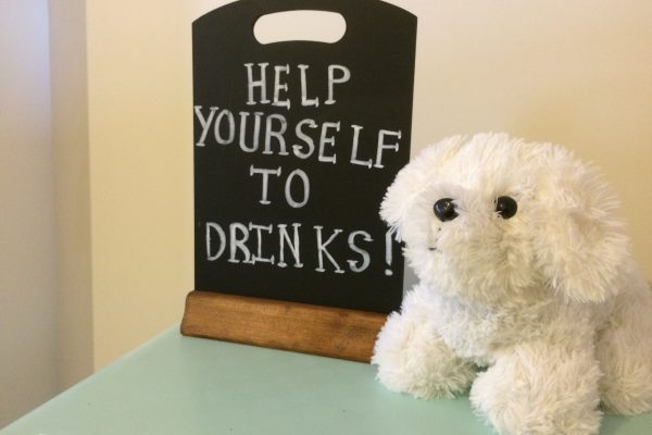 Our mascot next to a free drinks sign