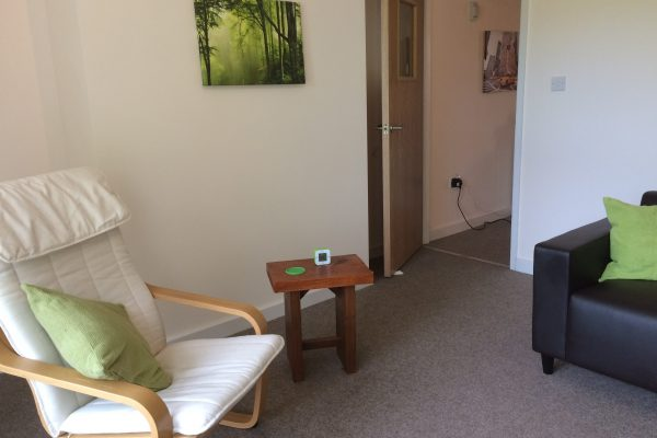 Picture of therapy room leading through to the waiting room